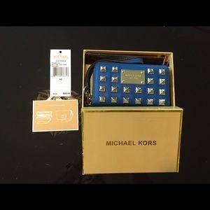 Cobalt blue Michael by Michael Kors wristlet.